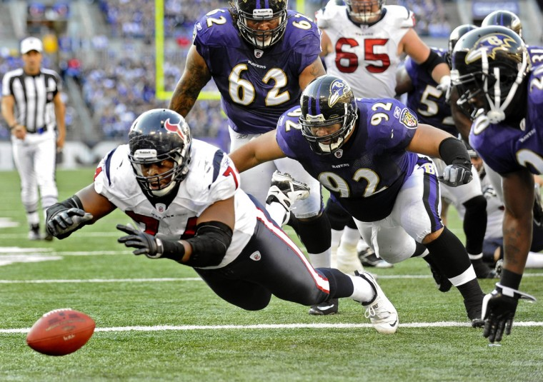 The Texans' Wade Smith, left, dives to recover a fumble in front of Ravens defenders Terrence Cody, Haloti Ngata and Ed Reed, right, in the Baltimore end zone to score a touchdown. (Kenneth K. Lam/Baltimore Sun)