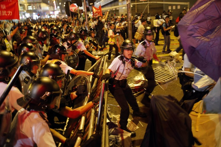 Riot police move into a protest site during clashes with pro-democracy protesters at the Mongkok shopping district of Hong Kong. Hong Kong pro-democracy activists recaptured parts of a core protest zone from police early on Saturday after hours of turmoil that the city's police chief warned undermined order and jeopardized public safety. (Carlos Barria/Reuters)