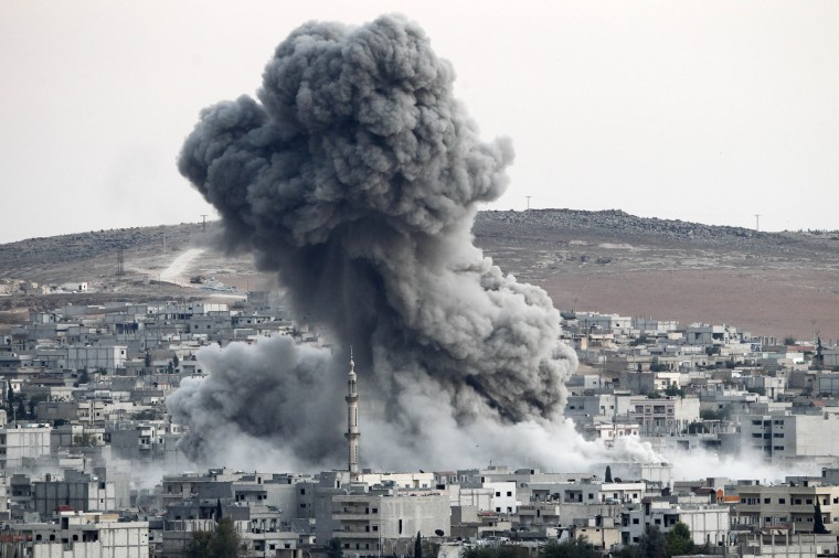 Heavy smoke rises following an airstrike by the US-led coalition aircraft in Kobani, Syria, during fighting between Syrian Kurds and the militants of Islamic State group, as seen from the outskirts of Suruc, on the Turkey-Syria border. Kurdish fighters in Syrian city of Kobani have pushed back Islamic State militants in a number of locations as U.S. airstrikes on ISIS positions continue in and around the city. Since mid-September more than 200,000 people from Kobani flee into Turkey. (Gokhan Sahin/Getty Images)