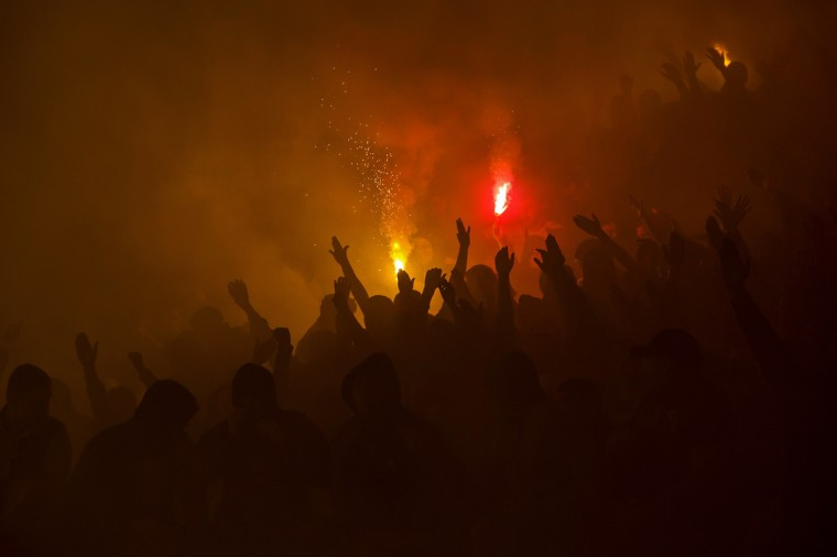 Partizan Belgrade's fans cheer and light flares during their match against Red Star Belgrade in Belgrade. The Serbian derby between bitter Belgrade rivals Partizan and Red Star produced more fireworks on the terraces as fans lit flares four days after a Euro 2016 qualifier was abandoned at the same venue. Play was twice held up for billowing smoke to clear at Partizan's end after their fans set off the pyrotechnics in response to identical action by Red Star supporters shortly before kickoff. (Marko Djurica/Reuters)
