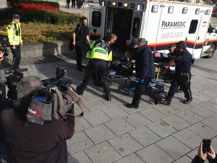 Police and medical personel moving a wounded person into an ambulance at the scene of a shooting at the National War Memorial in Ottawa, Canada. (Michel Comte/Getty Images)