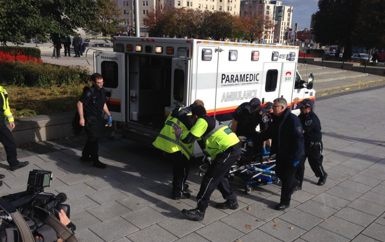 Police and paramedics transport a wounded Canadian soldier on October 22, 2014 in Ottawa, Ontario. (Michel Comte/Getty Images)