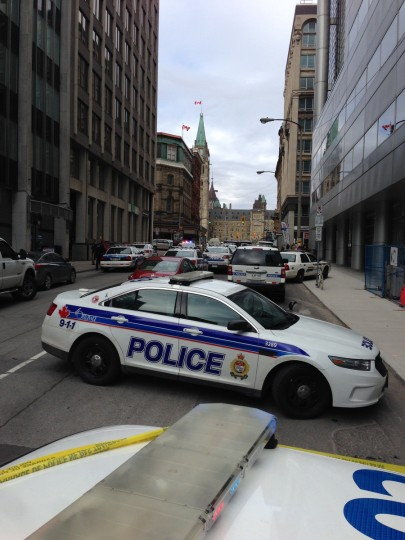Police vehicles block a road near Parliament on October 22, 2014 in Ottawa, Ontario. (Michel Comte/Getty Images)