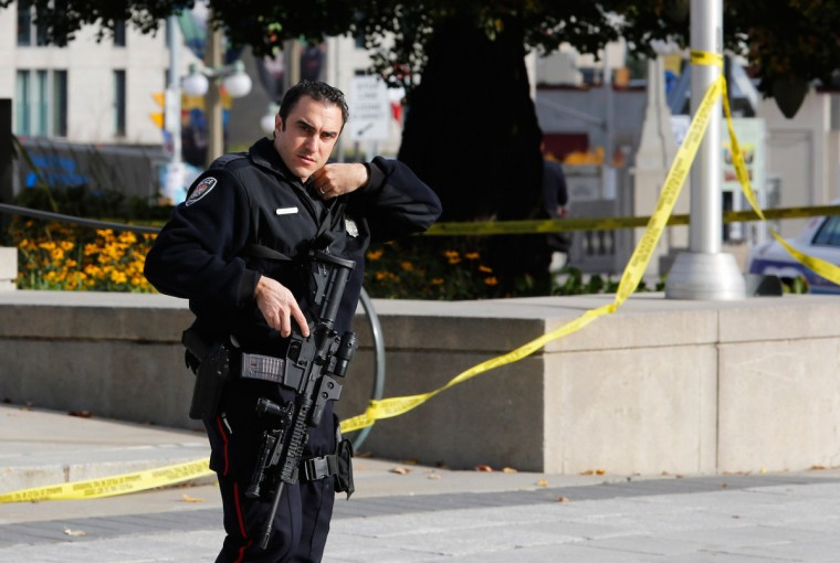 A police officer patrols the scene near the Canada War Memorial following a shooting incident in Ottawa October 22, 2014. A Canadian soldier was shot at the Canadian War Memorial and a shooter was seen running towards the nearby parliament buildings, where more shots were fired, according to media and eyewitness reports. (Chris Wattie/Reuters)