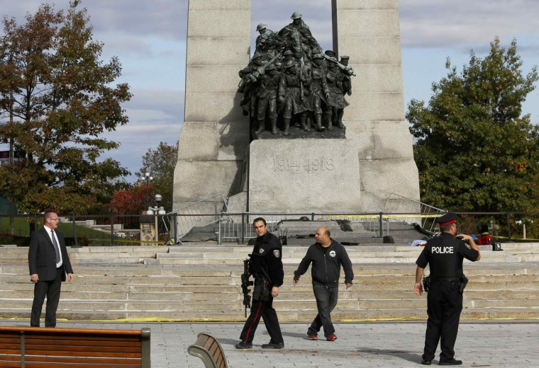 Police officers patrol the scene near the Canada War Memorial following a shooting incident in Ottawa October 22, 2014. A Canadian soldier was shot at the Canadian War Memorial and a shooter was seen running towards the nearby parliament buildings, where more shots were fired, according to media and eyewitness reports. (Chris Wattie/Reuters)