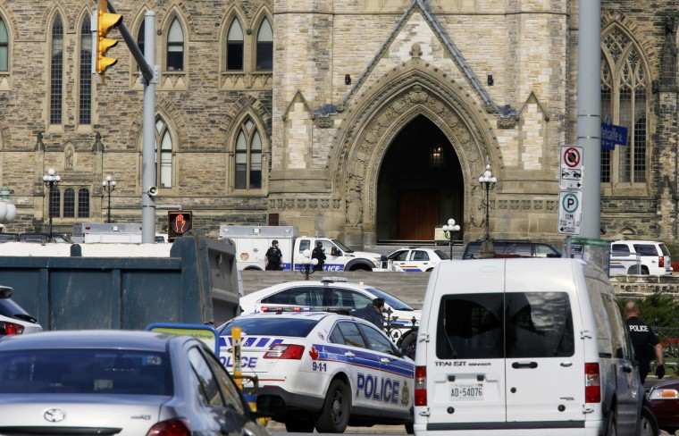 Police officers guard Parliament Hill following a shooting incident in Ottawa October 22, 2014. A Canadian soldier was shot at the Canadian War Memorial and a shooter was seen running towards the nearby parliament buildings, where more shots were fired, according to media and eyewitness reports. (Chris Wattie/Reuters)