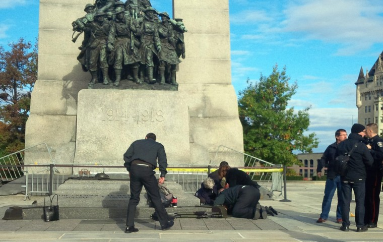A Canadian soldier who was shot outside the war memorial on Parliament Hill in tended to in Ottawa October 22, 2014. A Canadian soldier was shot at the Canadian War Memorial in Ottawa and a shooter was seen running towards the nearby parliament buildings, where more shots were fired, according to media and eyewitness reports on Wednesday. The buildings were put on lockdown as police and tactical teams converged on the area. The wounded soldier was taken into an ambulance where medical personnel could be seen giving him cardio-pulmonary resuscitation. (Daniel Thibeault/CBC/Reuters)