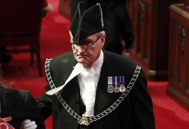 Sergeant-at-Arms Kevin Vickers is pictured in the Senate chamber on Parliament Hill in Ottawa in this file photo from June 3, 2011. According to Veterans Affairs Minister Julian Fantino, Vickers shot dead one of the suspects in the October 22, 2014 shooting incident on Parliament Hill. A gunman shot and wounded a soldier in Ottawa and then entered the country's parliament buildings chased by police, with at least 30 shots fired. (Chris Wattie/Reuters)
