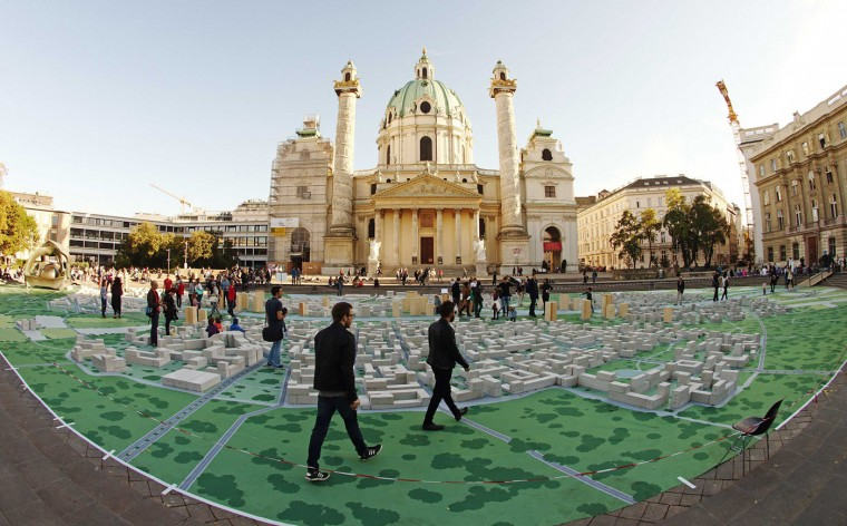"The arts project titled ""Hypotopia"", created by students of the Vienna University of Technology, is pictured in front of the Karlskirche church in Vienna October 16, 2014. The city model would accommodate 102,574 people and cost 19 billion euros ($ 24.3 billion), the sum that the students say will cost Austria to bail out the nationalized bank Hypo Alpe Adria. (Heinz-Peter Bader/Reuters)"