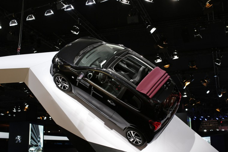 A new Peugeot 108 car is displayed on media day at the Paris Mondial de l'Automobile, October 2, 2014. The Paris auto show opens its doors to the public from October 4 to October 19. Benoit Tessier/Reuters photo