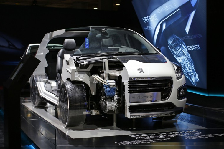 The Peugeot 3008 HYbrid4 car is displayed on media day at the Paris Mondial de l'Automobile, October 2, 2014. The Paris auto show opens its doors to the public from October 4 to October 19. Benoit Tessier/Reuters photo