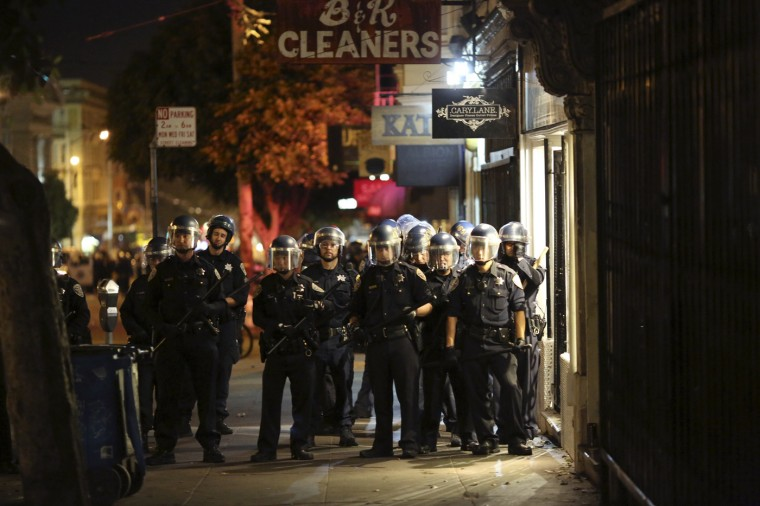 Police prepare to disperse a crowd gathered in the Mission District in San Francisco, California October 29, 2014. The San Francisco Giants beat the Kansas City Royals 3-2 on Wednesday to win their third World Series title in five seasons. REUTERS/Robert Galbraith