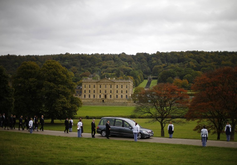 The funeral cortege for Deborah, Dowager Duchess of Devonshire leaves Chatsworth House in Edensor, central England, October 2, 2014. The last of the Mitford sisters, who transformed Chatsworth House in Derbyshire into a popular tourist attraction, died aged 94 last week. Staff from the stately home will line the route from Chatsworth to a church nearby, where her funeral service will be held. (Darren Staples/Reuters)