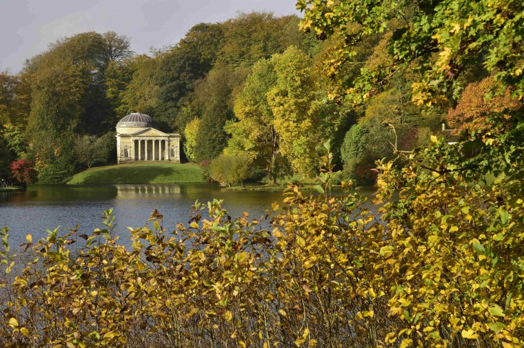 The Pantheon folly building is seen amongst autumnal colours of the gardens at Stourhead in Wiltshire, south west England, October 17, 2014. The partly private family owned and partly publically open estate consists of landscaped gardens around a natural valley with various classical temples and follies built over the past 300 years. (Toby Melville/Reuters)