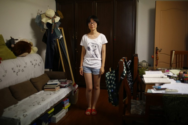 "Zhang Xiaoying, who was born in 1998, poses for a photograph in Shanghai August 24, 2014. Xiaoying said, ""Yes, because if I had a brother older than me, he could help me do many things, play with me."""