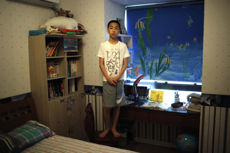 "Yao Jihan, who was born in 2000, poses for a photograph in Shanghai July 27, 2014. When asked if he would like siblings Jihan said: ""No. I don't know. Maybe, maybe, because it's troublesome. If there is one more person in this house, the room will not be big enough to hold two children. I don't feel lonely because I have a lot of friends."""