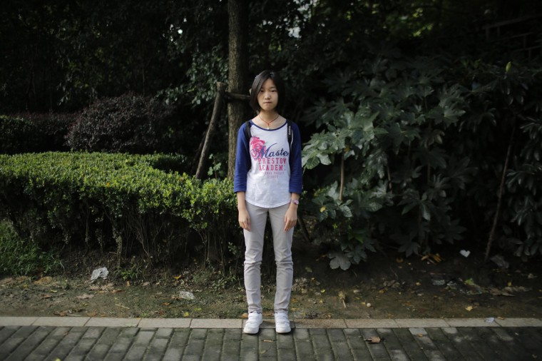 "Dai Jingting, who was born in 2001, poses for a photograph in Shanghai September 20, 2014. Jingting said she would like siblings ""because it would be boring for me to stay at home alone."""