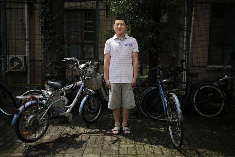 "Ding Tieru, who was born in 2002, poses for a photograph in Shanghai July 27, 2014. ""I have a cousin. I'd like to have a brother. Because we would be able to play together. I want more friends. We would be able to help each other in our studies,"" said Tieru."