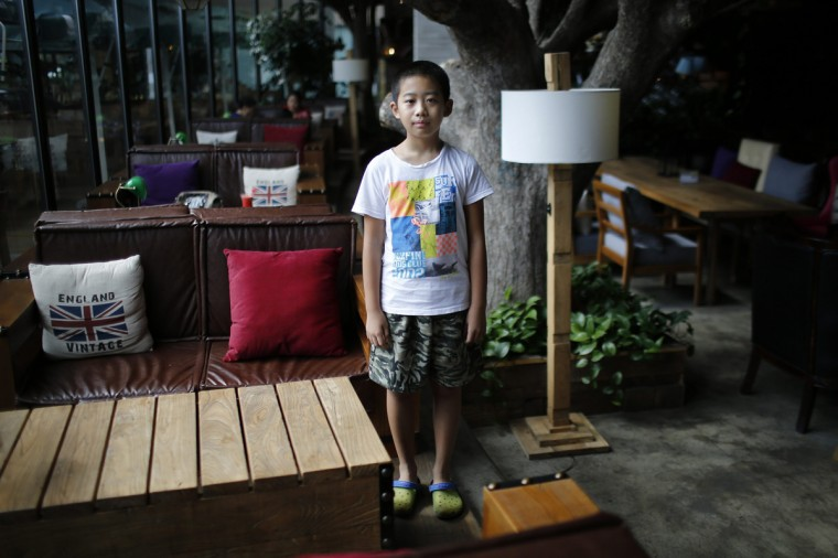 "Only child Qian Dingheng, who was born in 2005, poses for a photograph in Shanghai August 30, 2014. ""I don't want [a sibling], because he would interrupt my homework,"" Dingheng said."