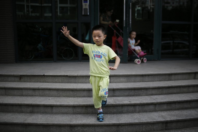 "Only child Ding Zhongcheng, who was born in 2008, poses for a photograph in Shanghai August 30, 2014. ""I don't want to have older brothers or sisters or younger ones either, because I don't want them to mess up all the things in the house. If there was a chance that my mother could give birth to older siblings, then I would accept it,"" Zhongcheng said."