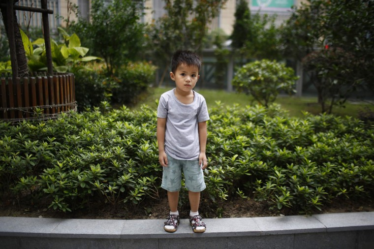 "Qin Wuyue, who was born in 2010, poses for a photograph in Shanghai August 22, 2014. When asked if he would like to have siblings, Wuyue said: ""No they're noisy."""