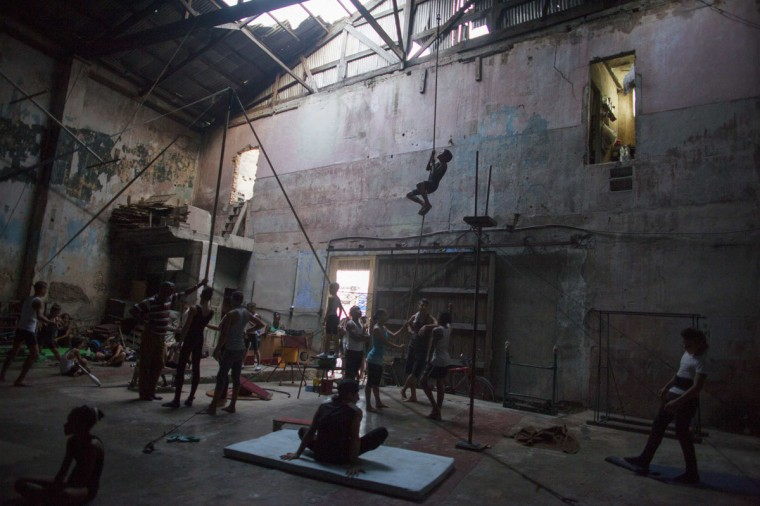 A child climbs a rope during a training session at a circus school in Havana. (Alexandre Meneghini/Reuters)