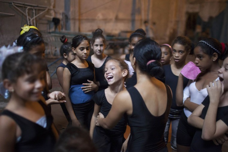 Children listen to instructions during a training session at a circus school in Havana. (Alexandre Meneghini/Reuters)