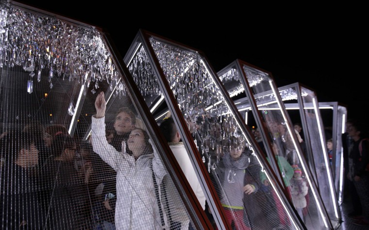"People walk through the installation ""Crystallation"" during the SIGNAL light festival in Prague October 16, 2014. (David W Cerny/Reuters)"