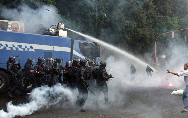 Anti-riot police use water cannon against anty-austerity protesters during a demonstration in Naples, October 2, 2014. Hundreds of protesters faced off riot police on Thursday outside the Capodimonte palace in the southern Italian city of Naples where the European Central Bank is holding one of its regular rate-setting meetings. (Stefano Renna/Reuters)