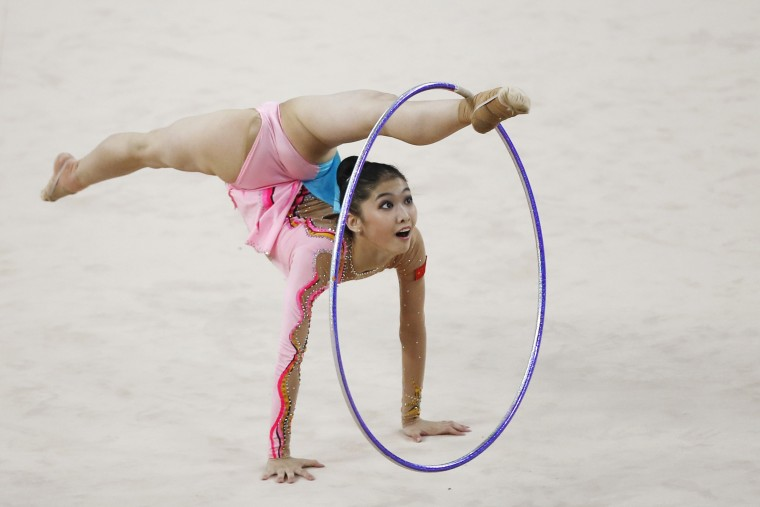 China's Liu Jiahui performs with the hoop in the individual rhythmic gymnastics competition at the Namdong Gymnasium Club during the 17th Asian Games in Incheon October 2, 2014. (Kim Hong-Ji/Reuters)