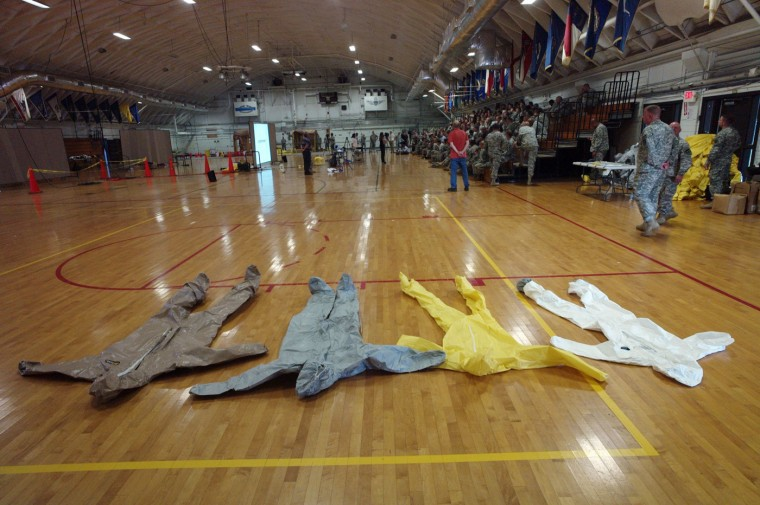 Protective suits are displayed as U.S. Army soldiers from the 101st Airborne Division (Air Assault), who are earmarked for the fight against Ebola, take part in training before their deployment to West Africa, at Fort Campbell, Kentucky October 9, 2014. (Harrison McClary/Reuters)