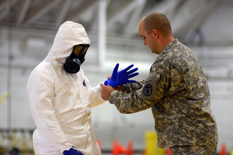 James Knight of U.S. Army Medical Research Institute of Infectious Diseases (USAMRIID) trains U.S. Army soldiers from the 101st Airborne Division (Air Assault), who are earmarked for the fight against Ebola, before their deployment to West Africa, at Fort Campbell, Kentucky October 9, 2014. The U.S. military is ramping up its response to the Ebola outbreak in West Africa, where it has already killed more than 3,400 people in Liberia, Sierra Leone and Guinea. (Harrison McClary/Reuters)