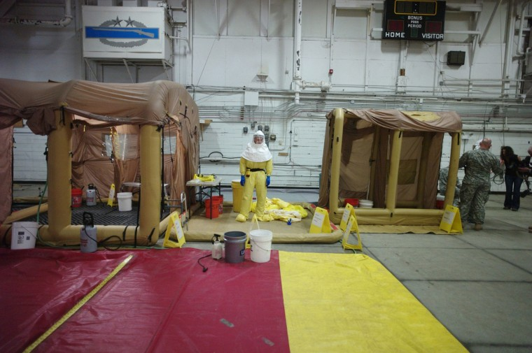 A U.S. Army soldier from the 101st Airborne Division (Air Assault), who are earmarked for the fight against Ebola, goes through decontamination process training before their deployment to West Africa, at Fort Campbell, Kentucky October 9, 2014. (Harrison McClary/Reuters)