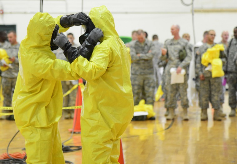 U.S. Army soldiers from the 101st Airborne Division (Air Assault), who are earmarked for the fight against Ebola, train before their deployment to West Africa, at Fort Campbell, Kentucky October 9, 2014. (Harrison McClary/Reuters)