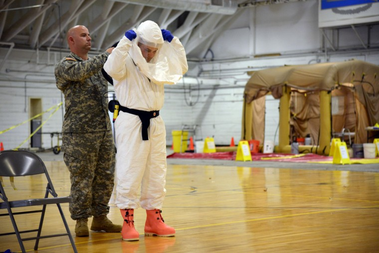 James Knight of U.S. Army Medical Research Institute of Infectious Diseases (USAMRIID) trains U.S. Army soldiers from the 101st Airborne Division (Air Assault), who are earmarked for the fight against Ebola, before their deployment to West Africa, at Fort Campbell, Kentucky October 9, 2014. (Harrison McClary/Reuters)