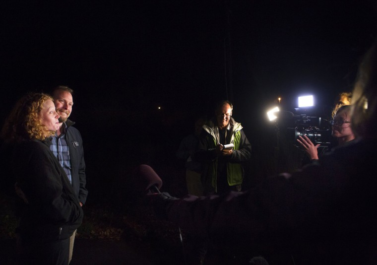 Nurse Kaci Hickox (L) and her boyfriend Ted Wilbur address the media during an informal meeting with the news media outside their home in Fort Kent, Maine October 29, 2014. Saying she will not be bullied by politicians, a Maine nurse is giving the state an ultimatum: Lift her Ebola quarantine by Thursday or she will disregard the restrictions and go to court. Hickox, 33, tested negative for Ebola after returning from treating patients in West Africa. Picture taken October 29, 2014. REUTERS/Ashley L. Conti/Bdn