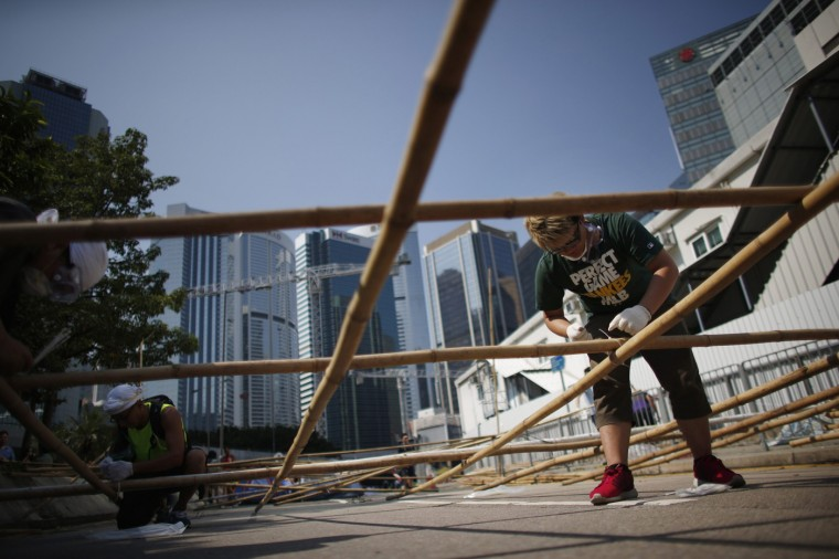 Pro-democracy protesters build a barricade with bamboo near the government headquarters in Hong Kong October 13, 2014. Hong Kong police on Monday removed some barricades erected by pro-democracy protesters in the Chinese-controlled city, but said protesters could remain on the streets they have occupied for the past two weeks. (Carlos Barria/Reuters)