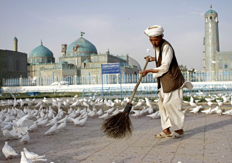 An Afghan man sweeps the yard of the shrine of Imam Ali, son in-law of Prophet Mohammad, before Eid al-Adha prayer is performed in Mazar-i-Shariff October 4, 2014. Muslims around the world celebrate Eid al-Adha to mark the end of the hajj pilgrimage by slaughtering sheep, goats, camels and cows to commemorate Prophet Abraham's willingness to sacrifice his son, Ismail, on God's command. (Anil Usyan/Reuters)