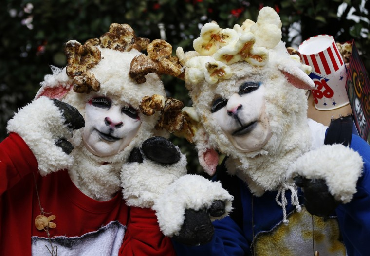Participants in costumes pose for a picture before a Halloween parade in Kawasaki, south of Tokyo, October 26, 2014. More than 100,000 spectators turned up to watch the parade, where 2,500 participants dressed up in costumes, according to the organizer. (Yuya Shino/Reuters)