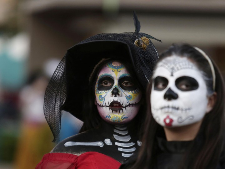 "Women with faces painted to look like the popular Mexican figure called ""Catrina"" are seen in Zapopan October 30, 2014. According to participants, about 271 women gathered in an attempt at the Guinness World Record for the largest gathering of women dressed to look like ""Catrina"", a character also known as ""The Elegant Death"" and created by Guadalupe Posada in the early 1900s. Mexicans will celebrate the annual Day of the Dead on November 1 and 2. (Alejandro Acosta/Reuters)"