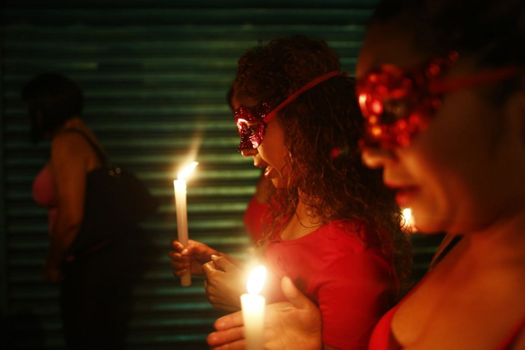Sex workers wear masks as they hold candles during a procession to remember their deceased colleagues, especially those who were violently murdered, in Mexico city October 27, 2014. The annual Day of the Dead is observed on November 1 and 2. (Edgard Garrido/Reuters)