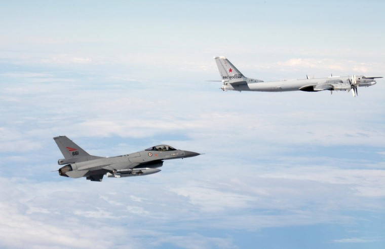 An undated handout photo provided by the Norwegian Army shows a Norwegian F-16 jet fighter (L) flying next to a Russian Tupolev Tu-95 strategic bomber over an unknown location during a military exercise. NATO aircraft tracked Russian strategic bombers over the Atlantic and Black Sea on October 29, 2014 and sorties of fighters over the Baltic in what the Western alliance called an unusual burst of activity at a tense time in East-West relations. REUTERS/Norwegian NATO