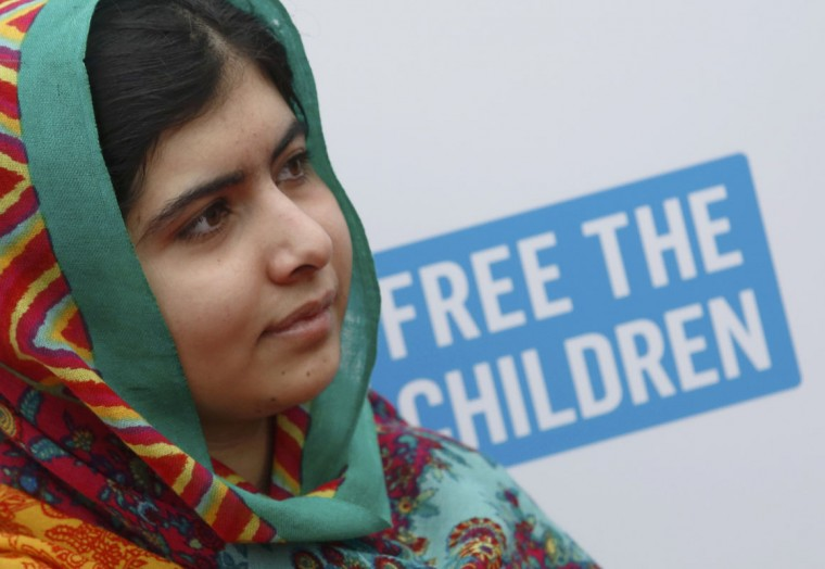 Malala Yousafzai arriving for the We Day UK event at Wembley Arena in London March 7, 2014. Pakistani teenager Malala Yousafzai, shot in the head by the Taliban two years ago for advocating girls' right to education, and Indian children's right advocate Kailash Satyarthi won the 2014 Nobel Peace Prize on Ocotber 10, 2014. (Luke MacGregor/Reuters)