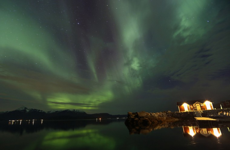 An Aurora Borealis (Northern Lights) is seen over a fishing harbour at the Bals-Fiord north of the Arctic Circle, near the village of Mestervik late September 30, 2014. (Yannis Behrakis/Reuters)