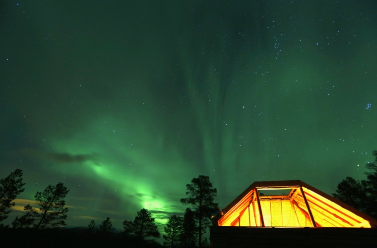 An Aurora Borealis (Northern Lights) is seen over a mountain camp north of the Arctic Circle, near the village of Mestervik late September 30, 2014. (Yannis Behrakis/Reuters)