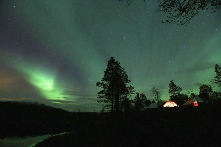 An Aurora Borealis (Northern Lights) is seen over a mountain camp north of the Arctic Circle, near the village of Mestervik early October 1, 2014. (Yannis Behrakis/Reuters)