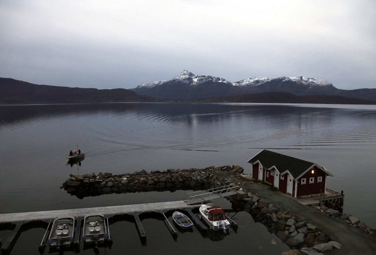 Tourists return to a small harbor after spending the day fishing in North-Fiord, north of the Arctic Circle, near the village of Mestervik in northern Norway September 28, 2014. Tourists are gathering this time of the year in northern Norway to admire the phenomenon of the Northern Lights. (Yannis Behrakis/Reuters)