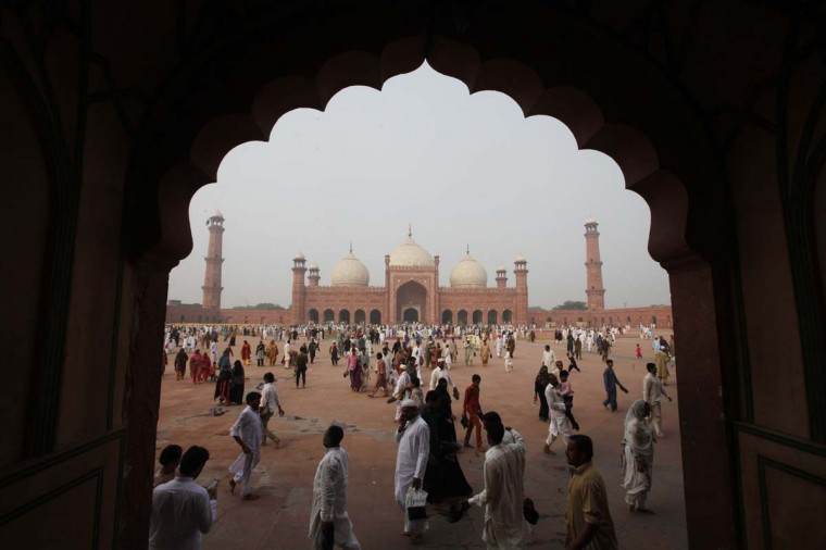 Muslims walk near the Badshahi mosque after attending a mass prayer for Eid al-Adha in Lahore October 6, 2014. Muslims across the world celebrate the annual festival of Eid al-Adha, which marks the end of the annual Haj pilgrimage, by slaughtering goats, sheep, cows and camels in commemoration of the Prophet Abraham's readiness to sacrifice his son to show obedience to Allah. Eid al-Adha in Pakistan falls on October 6. (Mohsin Raza/Reuters)