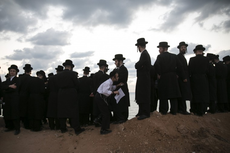 Jewish worshippers take part in the Tashlich ritual on the shore of the Mediterranean Sea in Herzliya, near Tel Aviv October 2, 2014, ahead of Yom Kippur, the Jewish Day of Atonement, which starts at sundown Friday. Tashlich is a ritual of casting away sins of the past year into the water. (Baz Ratner/Reuters)