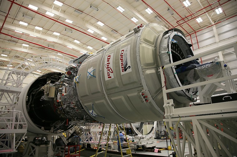 Orbital Sciences Corp. completes a final cargo load of the Cygnus cargo spacecraft in preparation for launch to the International Space Station on October 23, 2014, at the Horizontal Integration Facility at NASA's Wallops Flight Facility in Virginia, as seen in this handout photo from NASA. An unmanned Antares rocket exploded seconds after liftoff from a commercial launch pad in Virginia on Tuesday, marking the first accident since NASA turned to private operators to deliver cargo to the International Space Station, but officials said no one was hurt. (NASA)